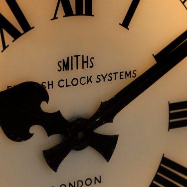 large antique illuminated station clock